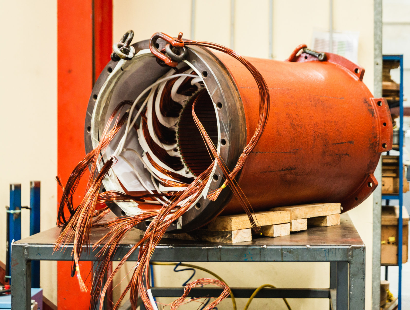 Large electric motor, partially disassembled, up on bench for repair